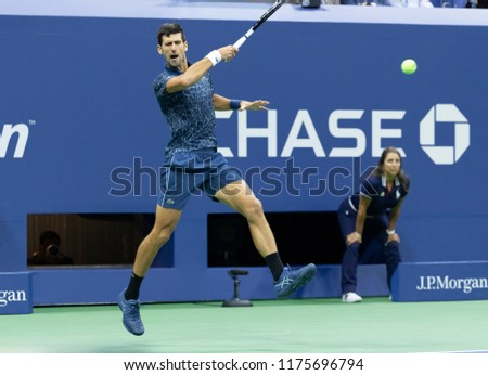 New York, NY - September 9, 2018: Novak Djokovic of Serbia returns ball during men's single final of US Open 2018 Juan Martin del Potro of Argentina at USTA Billie Jean King National Tennis Center