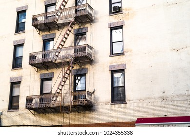 New York, NY/ United States- February 2018: White wall, fire escapes and windows
