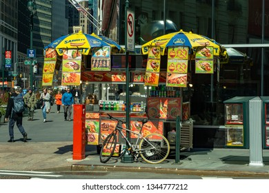New York, NY /United States - Mar. 20, 2019: A landscape view of a New York City food cart