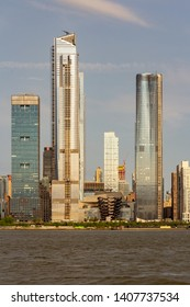 New York, NY / United States - May 25, 2019: closeup vertical view of the Hudson Yards Development seen from the Hudson River.