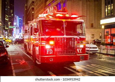 New York, NY / USA - 02/24/2018: Fire truck with emergency lights on the street of Manhattan