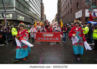 New York, NY / USA - 02/25/2018: Chinese Lunar New Year Parade in Chinatown New York under rain