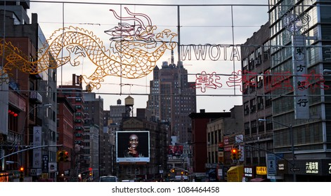 New York, NY / USA - 04.14.2018: Selfies on Iphone X billboard in Chinatown New York city in evening