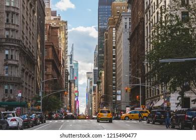 New York, NY / USA - 10 14 2018: New York city street scene, Skyscrapers, traffic, architecture and lifestyle scene.