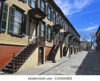 New York, NY / USA - 4/15/15: Rowhouses (1890-1902) of the Jumel Terrace Historic District, in the Washington Heights section of Manhattan. The Morris-Jumel Mansion is in the distance, on the right.