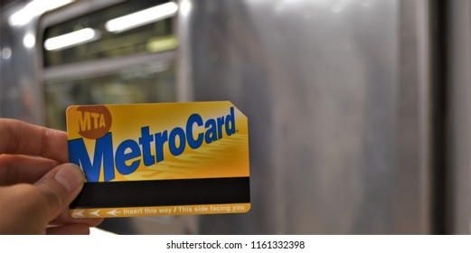 New York, NY/ USA- 8-19-18: NYC MTA Metrocard New York City Subway Train in the Background Metro Card Closeup