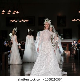 New York, NY, USA - April 12, 2018: Models walk runway for Reem Acra Bridal Spring/Summer 2019 collection during NY Bridal Wweek at NY Public Library, Manhattan