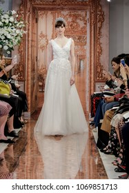 NEW YORK, NY, USA - APRIL 12, 2018: A model walks runway for Theia Spring 2019 collection during New York Bridal Week at the Theia Showroom, Manhattan