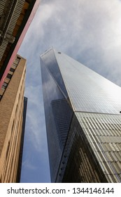 NEW YORK, NY, USA -  APRIL 16, 2015: One World Trade center building with blue sky in NYC