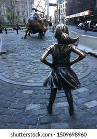 New York, NY, USA April 22, 2018 Defiant Girl stares down the Wall Street Bull in New York's Financial District