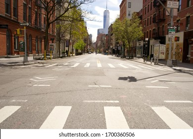New York, NY / USA - April 10, 2020: Normally busy streets in lower Manhattan are virtually deserted after New York City officials imposed a COVID-19 lockdown of stores, businesses and restaurants.