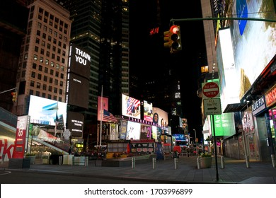 New York, NY / USA - April 13, 2020: Government imposed COVID-19 closures in the US have left the normally teeming nighttime streets of Times Square and other iconic Manhattan areas devoid of people.