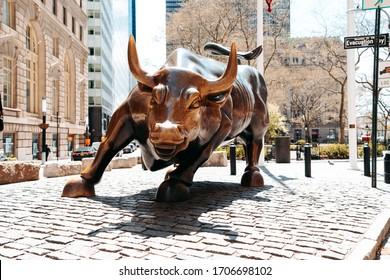 New York, NY / USA - April 16 2020: Wall Street Charging Bull near the Bowling Green park