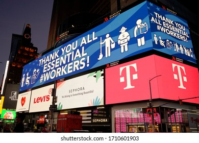 New York, NY / USA - April 22, 2020: The iconic jumbotron billboards in Times Square carry messages of support for America's essential workers who are manning their posts during the COVID-19 outbreak.
