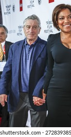 New York, NY, USA - April 25, 2015: Robert De Niro (L) and Grace Hightower attend 2015 TFF closing night, 25th anniversary of Goodfellas, co-sponsored by Infor and Roberto Coin at Beacon Theatre