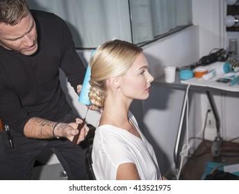 New York, NY, USA - April 13, 2016: A model prepares backstage for Marchesa Spring/Summer 2017  Bridal Presentation at Canoe Studio, Manhattan