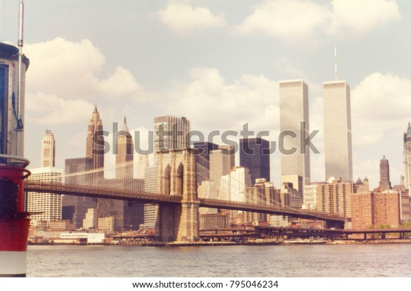 NEW YORK, NY, USA. APRIL 1980. View of the Brooklyn Bridge with Manhattan financial district and the Twin Towers.