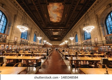 New York, NY, USA - August 13, 2019: View of the New York Public Library showcasing its historic architecture with locals and students reading books and surfing on the Internet.