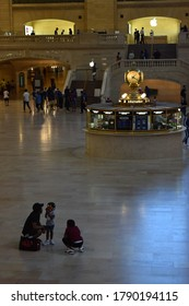 New York, NY / USA - August 4, 2020: New Yorkers in Grand Central Station During Phase 4 Covid-19 Pandemic, Man with Two Children