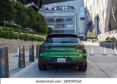 New York, NY / USA - August 1 2020: green suv parked near skyscraper.