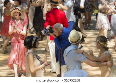 New York, NY USA - August 16, 2015: Bill Cunningham takes photos at 10th annual Jazz Age lawn party by Michael Arenella & Dreamland Orchestra on Governors Island