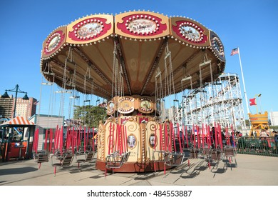 New York, NY, USA August 30, 2016: Swing ride: Coney Island's fairground attraction. Coney Island Luna Park has every year about 450,000 visitors with over 1.7 million rides.