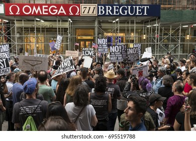 New York, NY USA - August 13, 2017: About 400 demonstrators attend rally against nationalist protest in Charlottesville, Virginia ahead of President Trump visit on 5th Avenue near Trump Tower