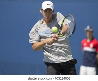 New York, NY USA - August 25, 2017: JC Aragone of USA returns ball during qualifying game against Akira Santillan of Australia at US Open 2017