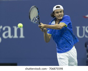 New York, NY USA - August 31, 2017: Taro Daniel of Japan returns ball during match against Rafael Nadal of Spain at US Open Championships at Billie Jean King National Tennis Center