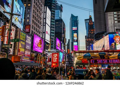 NEW YORK, NY, USA - DECEMBER 27, 2018: Beautiful evenings with street lights on crowded Times Square