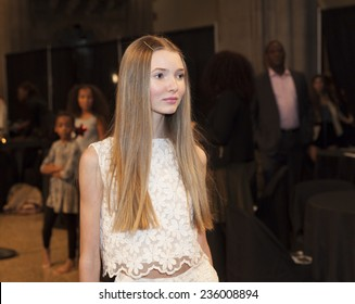 New York, NY USA - December 05, 2014: Girl walks runway for Bonnie Young collection during rehearsal at United Against Ebola Benefit at Landmark on the Central Park West
