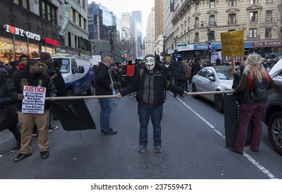 New York, NY USA - December 13, 2014: Protesters march against police brutality and grand jury decision on Eric Garner case on Broadway