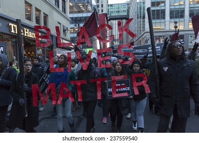 New York, NY USA - December 13, 2014: Protesters march against police brutality and grand jury decision on Eric Garner case on Broadway and 32nd street