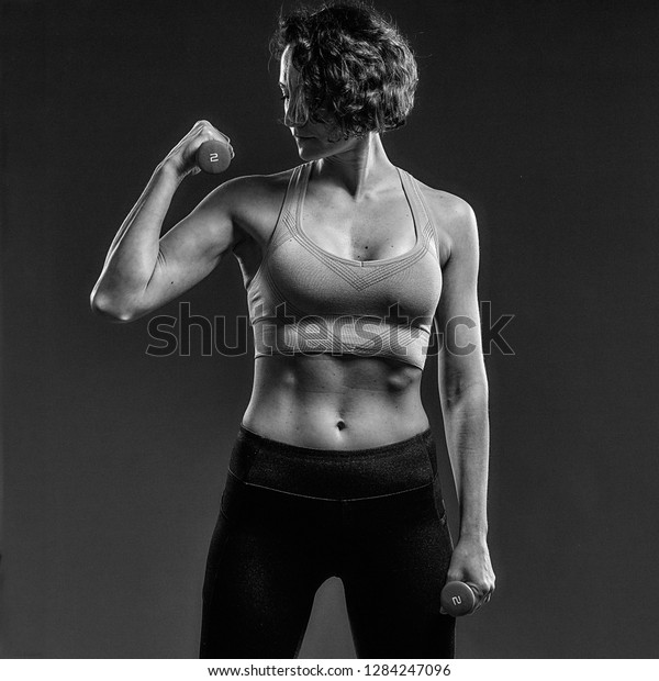 New York, NY / USA - December 28, 2018: portrait of a fitness model with a muscular body, wearing a sports bra and leggings. The images are perfect for usage as fitness motivation.