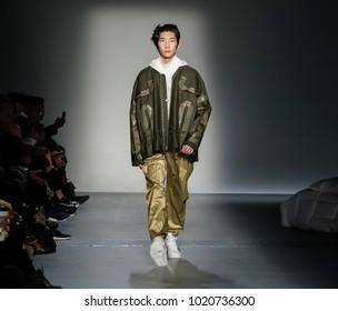 New York, NY, USA - February 6, 2018: A model walks runway for Feng Chen Wang Fall/Winter 2018 runway show during NY Fashion Wweek: Men's at Pier 59 Studios, Manhattan