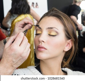 New York, NY, USA - February 8, 2018: A model prepares backstage for the Pamella Roland Fall/Winter 2018 runway show during New York Fashion Week at Pier 59 Studuos, Manhattan