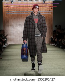 New York, NY, USA - February 4, 2019: A model walks runway at the Todd Snyder Fall/Winter 2019 Collection during New York Fashion Week: Men's at Pier 59 Studios, Manhattan