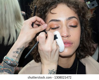 New York, NY, USA - February 8, 2019: A model prepares backstage for the  Cushnie Fall/Winter 2019 collection during New York Fashion at Spring Studios, Manhattan