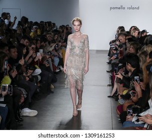 New York, NY, USA - February 7, 2019: A model walks runway for the Pamella Roland Fall/Winter 2019 collection during New York Fashion Week at Pier 59 Studuos, Manhattan