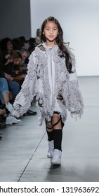 New York, NY, USA - February 9, 2019: A model walks runway for the Custo Barcelona Fall/Winter 2019 collection during New York Fashion Week at Pier 59 Studios at Chelsea Piers, Manhattan