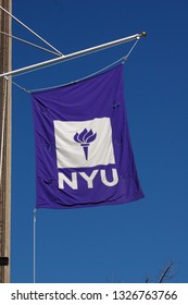 New York, NY / USA - February 26 2019: Banner for NYU New York University hanging outside NYU dental graduate school facility in Manhattan.