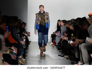 New York, NY, USA - February 5, 2020: A model walks runway for the Todd Snyder Fall/Winter 2020 collection at Pier 59 Studios, Manhattan