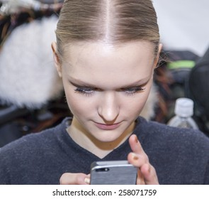 New York, NY, USA - February 16, 2015: A model prepares backstage for Dennis Basso Fall 2015 Runway show during Mercedes-Benz Fashion Week New York at the Theatre at Lincoln Center, Manhattan