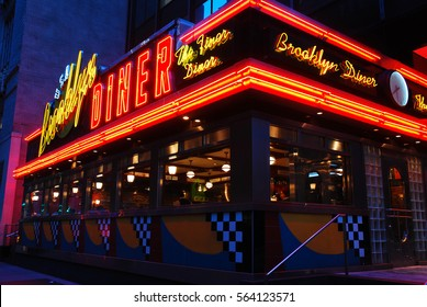 New York, NY, USA February 23 The Brooklyn Diner glows in twilight.  The diner offers typical American fare and, despite its name, is located in Manhattan
