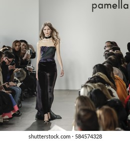 New York, NY, USA - February 10, 2017: A model walks runway for the Pamella Roland Fall/Winter 2017 runway show during New York Fashion Week at Pier 59 Studios at Chelsea Piers, Manhattan
