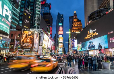 New York, NY, USA- Jan 28, 2017.  Time Square by night with crowds of tourists and LED signs lighting up the place.