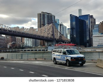 New York, NY / USA - January 1 2019: NYPD van parked in front of Queensboro Bridge