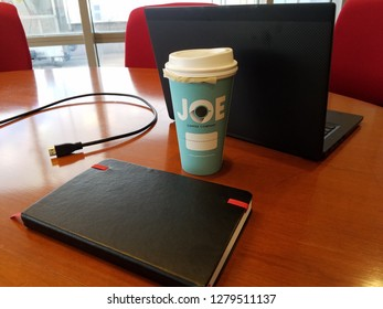 New York, NY / USA - January 9 2019: smart working, featuring cup from Joe Coffee. All trademarks belong to Joe Coffee Company. Joe Coffee is family owned, founded in 2003 in New York City.