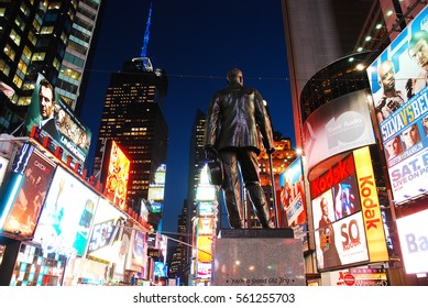 """New York, NY, USA  January 31, 2011 A statue of songwriter and performer George M Cohan stands in in Times Square.  He wrote the famous New York ode """"Give my Regards to Broadway."""""""