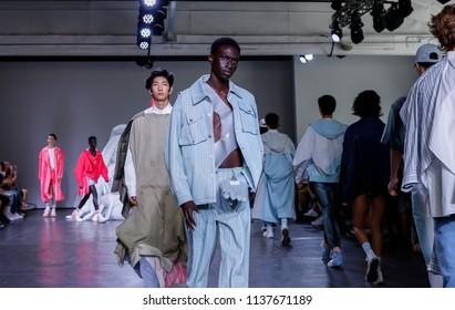 New York, NY, USA - July 10, 2018: Models walk runway for Feng Chen Wang Spring/Summer 2019 runway show during NY Fashion Wweek: Men's at Industria Studios, Manhattan